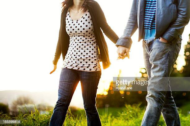 Couple Walking in City Park