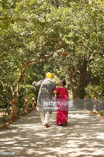 Couple walking in garden