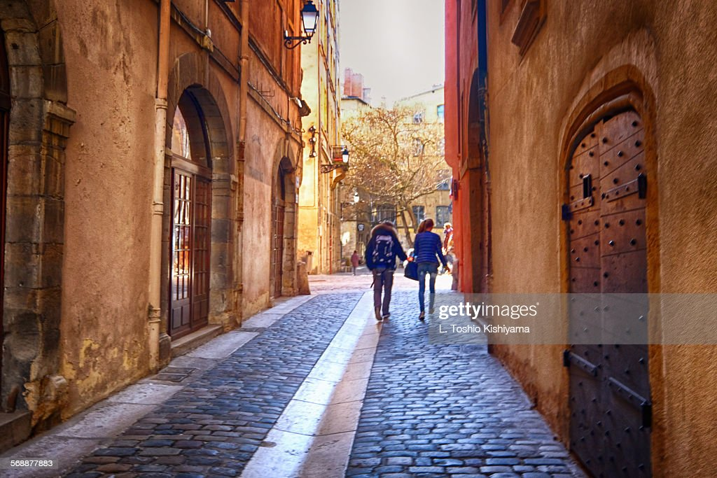 Couple walking in Lyon, France : Stock Photo