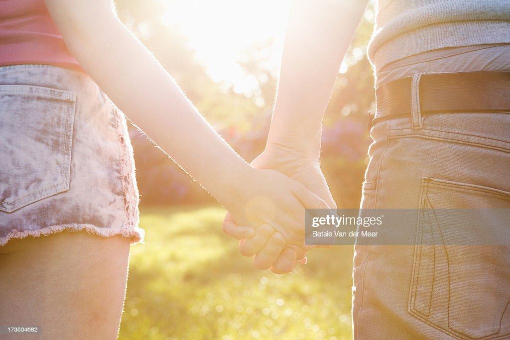 Couple walking in sunshine. : Stock Photo