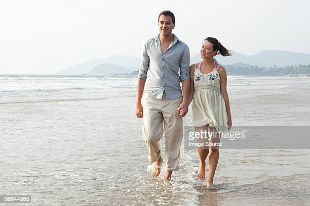 Couple walking in the sea