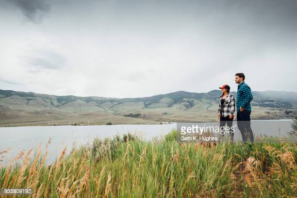 couple walking near dillon reservoir, looking at view, silverthorne, colorado, usa - silverthorne stock photos and pictures
