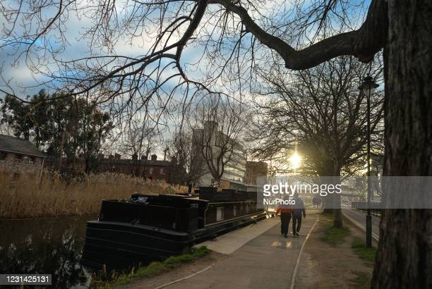 Couple walking near the Crand Canal in Dublin during Level 5 Covid-19 lockdown. On Saturday, February 27 in Dublin, Ireland.