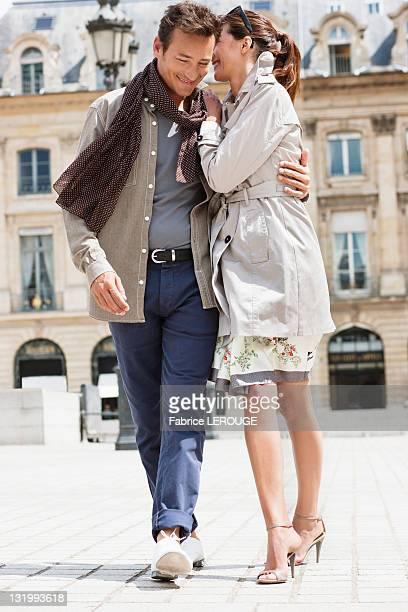 Couple walking on a street, Paris, Ile-de-France, France