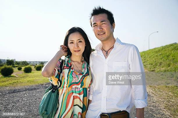 Couple walking on road, smiling