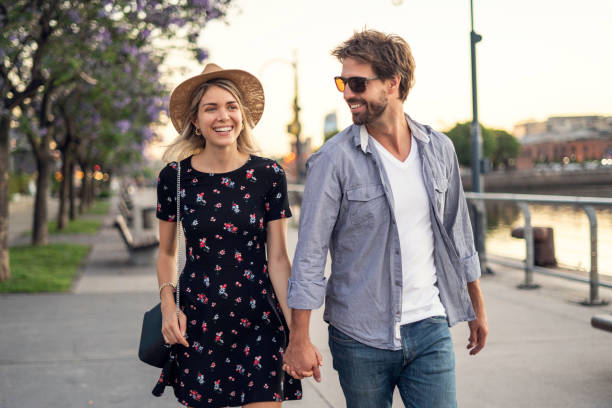 couple walking on street - young couple stock pictures, royalty-free photos & images