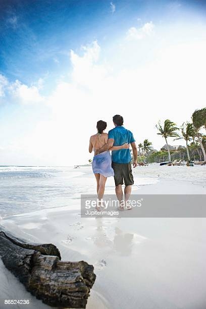 couple walking on the beach - mayan riviera stock photos and pictures