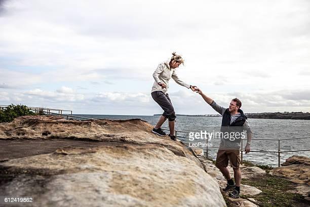Couple walking on the cliffs around Bondi Beach - Sydney