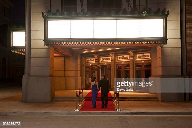couple walking on the red carpet - premiere stock pictures, royalty-free photos & images