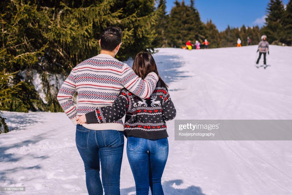 Couple walking on the snow : Stock Photo