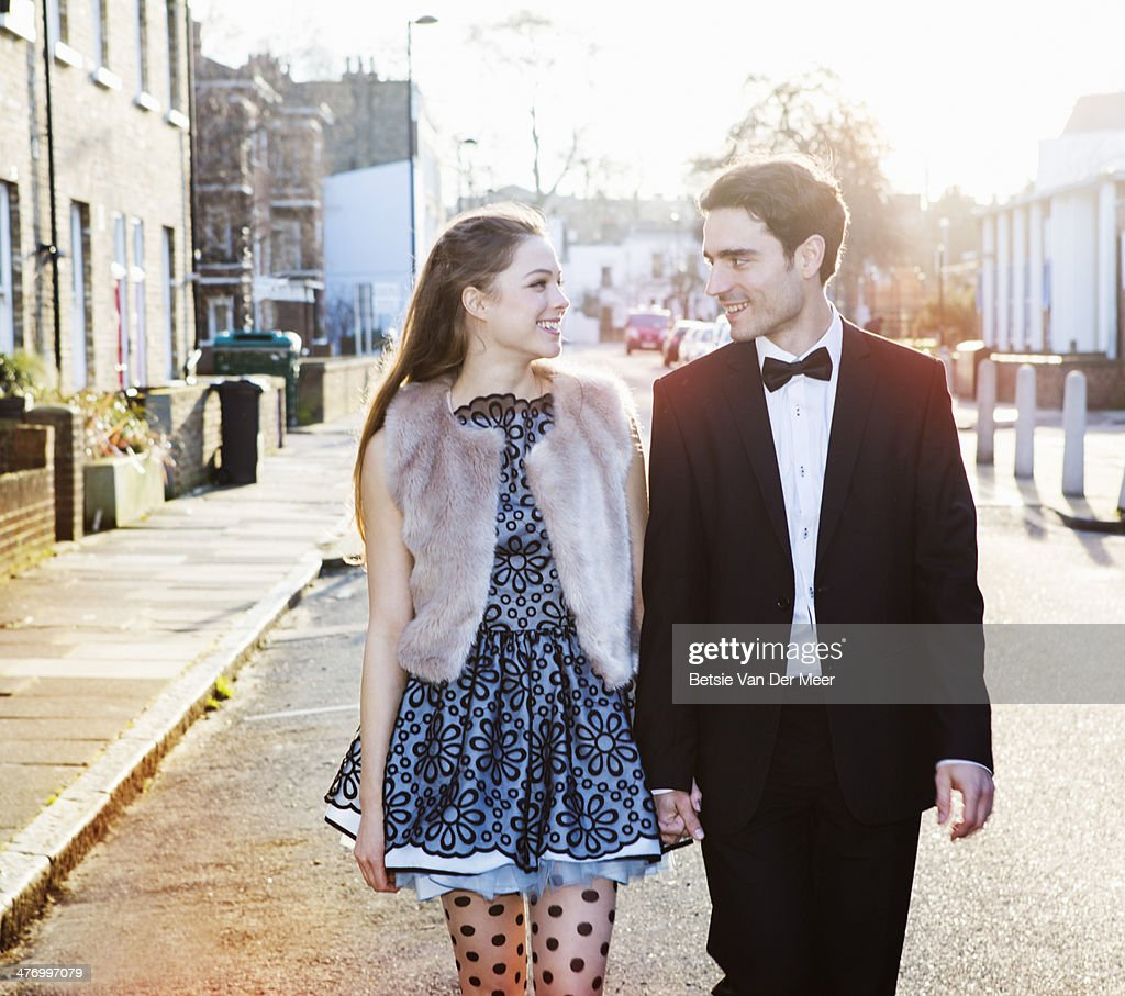 Couple walking on the street, holding hands. : Stock Photo