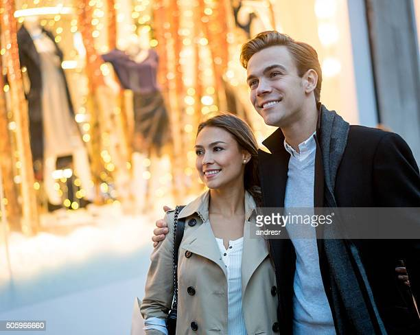 Couple walking on the street looking at window shops