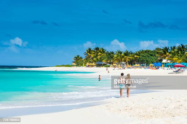 Couple walking on world class Shoal Bay East beach, Anguilla, British Oversea territory, West Indies, Caribbean, Central America