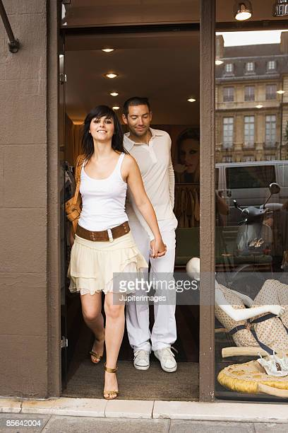 Couple walking out of clothing store