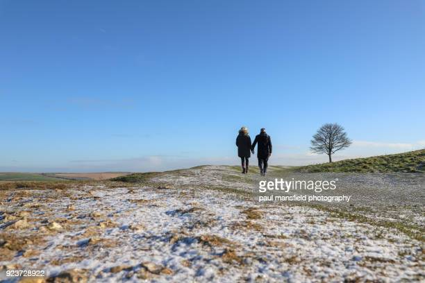 couple walking - sussex stock pictures, royalty-free photos & images