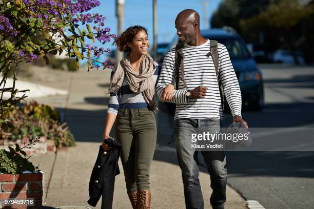 Couple walking the steep hills of San Francisco