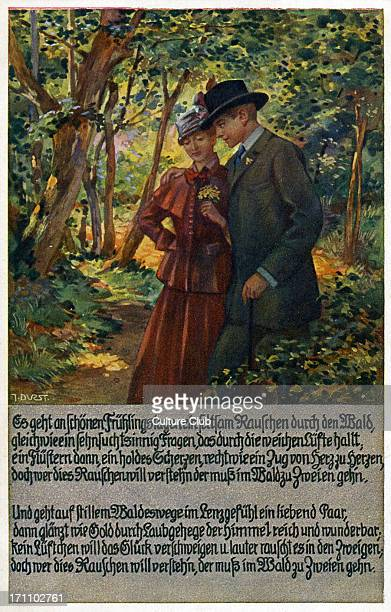 Couple walking through a wooded area Caption 'On fine Spring days a curious rustling goes through the woods just like a wishful question echoing in...
