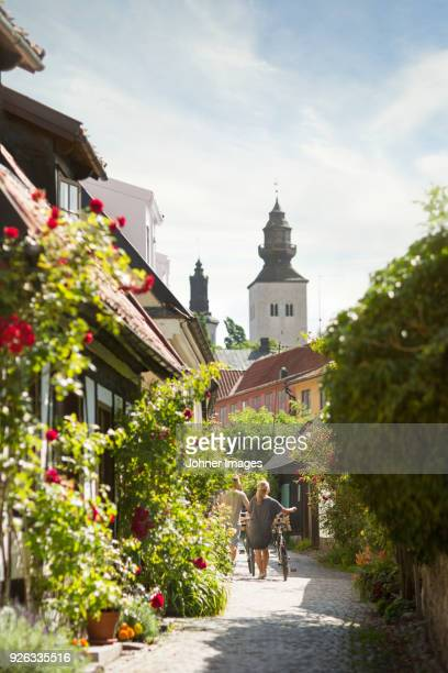 couple walking through old town - stockholm stock pictures, royalty-free photos & images