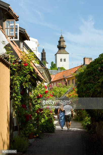 couple walking through old town - gotland bildbanksfoton och bilder
