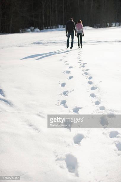 Couple walking through snow