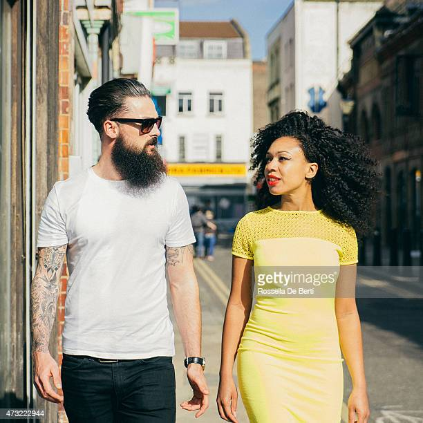 Couple Walking Through The City