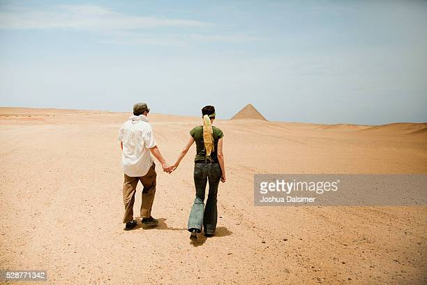 Couple walking through the desert