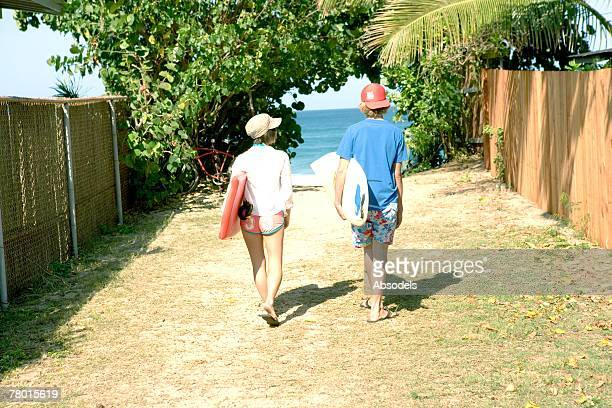 Couple walking to the ocean