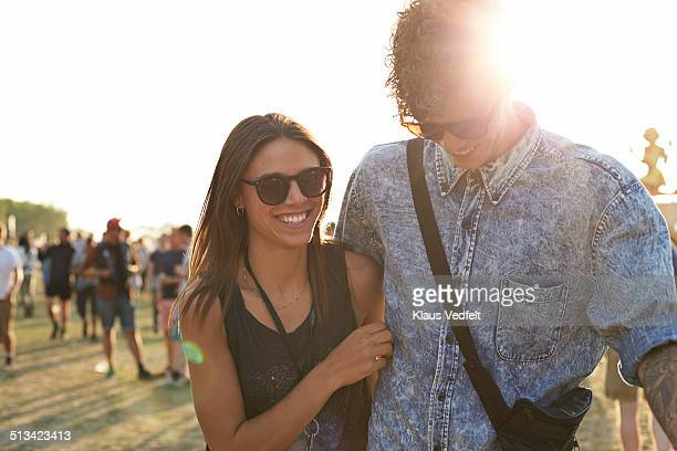Couple walking together at festival & laughing
