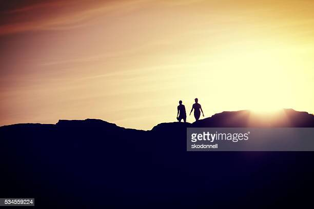 couple walking together at sunset - billings montana stock pictures, royalty-free photos & images