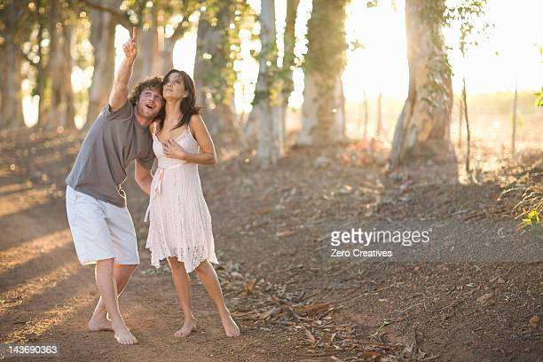 Couple walking together on dirt road