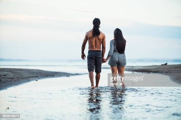 Couple walking towards beach.