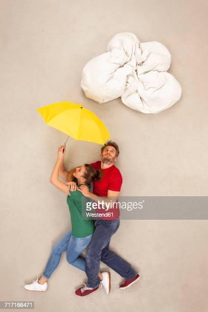 Couple walking under one umbrella