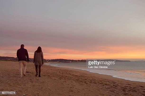 Couple walking under the sunset