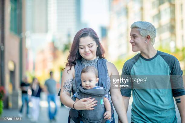 Couple Walking With Baby