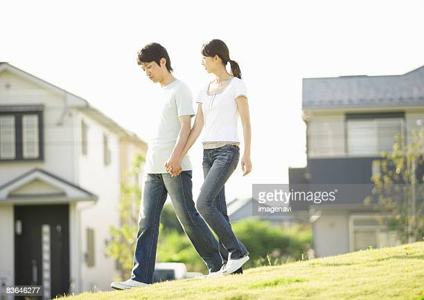 Couple walking with holding hands