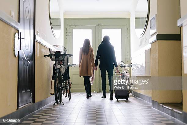 Couple walking with Suitcase