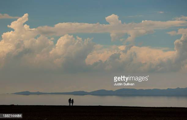 Couple walks along the banks of the Great Salt Lake at Antelope Island on August 01, 2021 near Syracuse, Utah. As severe drought continues to take...