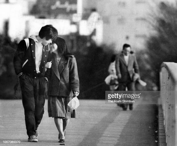 Couple walks at Yoyogi Park on March 29, 1984 in Tokyo, Japan.