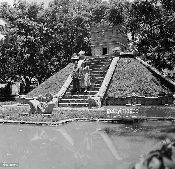 A couple walks down the steps of a Mayan pyramid in La Concordia Park Tegucigalpa Honduras