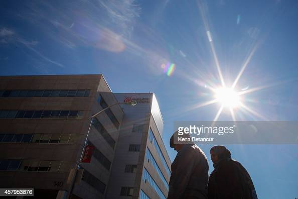 A couple walks in front of University Hospital in Newark where Nurse
