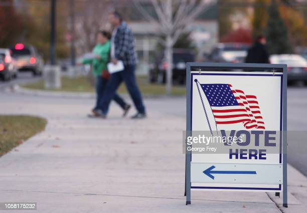A couple walks into a polling center to vote in the midterm elections on November 6 2018 in Provo Utah Utah early voting has been highest ever in...