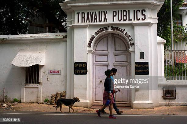 A couple walks past a French colonial building in Puducherry Puducherry formerly known as Pondicherry is a Union Territory of India In 1674...