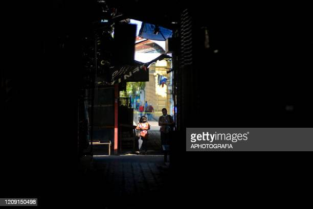 A couple walks through a closed market on April 2 2020 in San Salvador El Salvador On March 21st President Nayib Bukele declared a 30day mandatory...