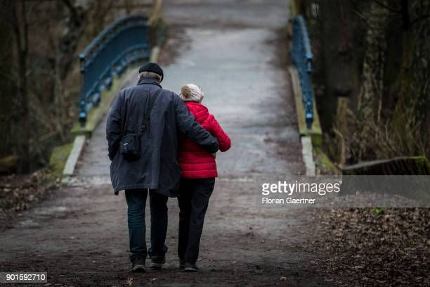 A couple walks through a forest on January 05 2018 in Berlin Germany