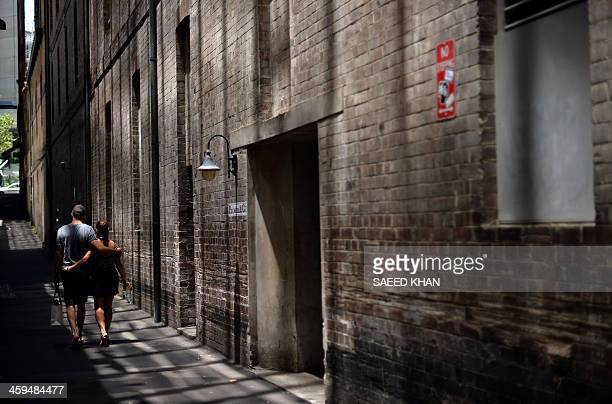 A couple walks through an alley to avoid the rush of shoppers looking for postChristmas sales in the central business district of Sydney on December...