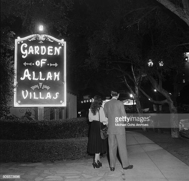 A couple walks to Garden of Allah hotel on Sunset and Havenhurst in Los AngelesCalifornia