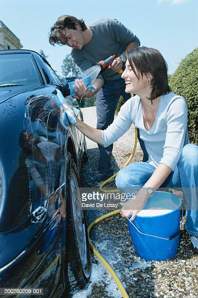 Couple washing car