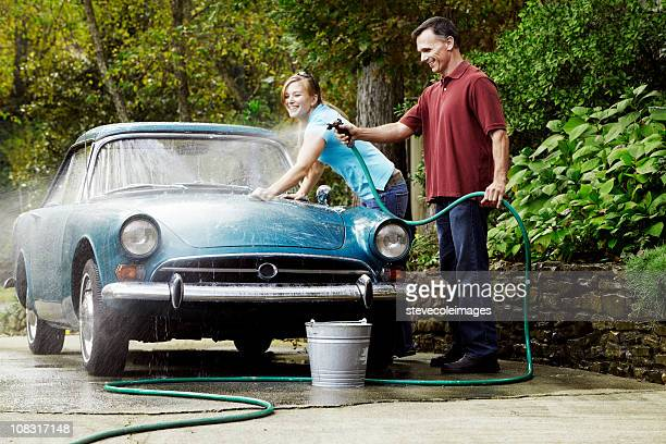 couple washing vintage car - couples showering stock pictures, royalty-free photos & images