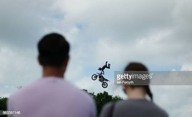A couple watch a motor cycle stunt display during the Duncombe Park Country Fair on May 28 2018 in Helmsley England Set in the grounds of one of...