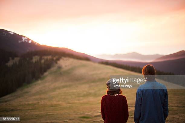 Couple watch mountain sunset